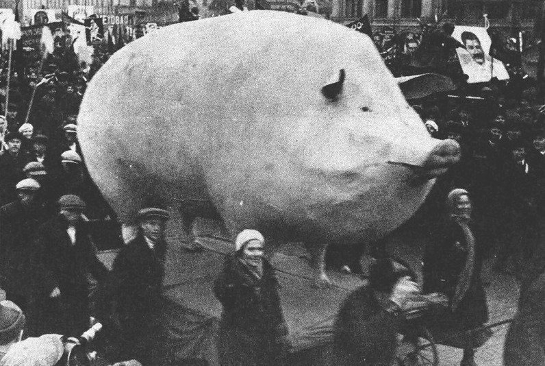 Soviet demonstration with a large sculpture of a pig, late 1920-30's