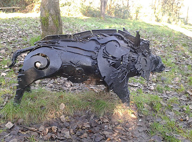 At Sandy Water Park, Llanelli, the Mabinogion Woods hold various sculptures – this boar is actually intended as Twrch Trwyth: https://smiths29.wixsite.com/sandy-water-park/mabinogion-woods